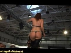 Three babes scansl on stage teasing a horny guy hard