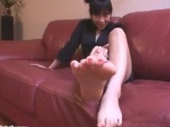 Sexy asian girl shows her feet