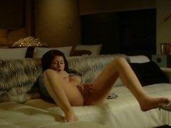 Brunette pornstar trying to reach orgasm