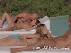 Two couples intercourse together outside