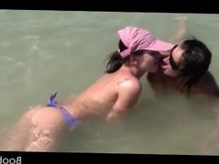 Lesbian amateurs having a threesome in the sea