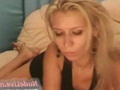 Super Sexy Blonde Teen plays on the bed on Webcam
