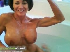 Horniest and very muscled Granny bathing ini the tub on Webcam