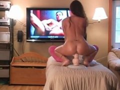 Hot wife rides big toy while looking at pictures of hot men