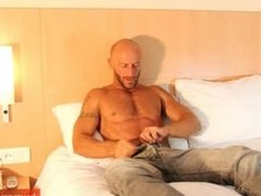 A sexy hunk get wanked his huge cock by us!