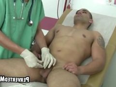 Muscular hunk getting his cock tugged by his doctor