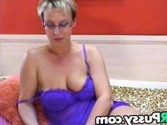 Big breasted mature masturbates
