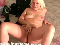 Blonde amateur fingers her pussy at a party