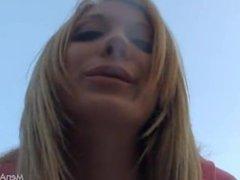 Blonde girl smoking outdoor