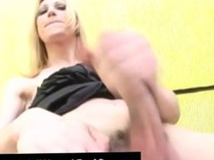 Blonde tranny babe tugging on her cock