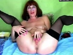 Busty Mature With Glasses Stripping & Fingering Hairy Pussy
