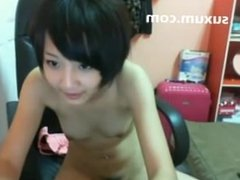 Cute Asian teen getting naked and masturbating fingers her tight pussy