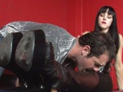 Slave licks and worships Mistress' boots