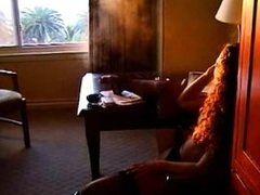 Girl with curly hair is a sexy smoker