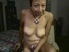 Asian mature toying her pussy