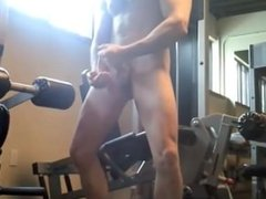 wanking off and cumming a huge load in the gym