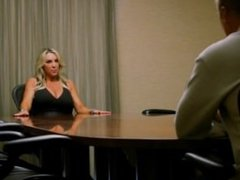 Gives a POV blowjob in the boardroom