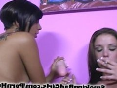Two teens suck big dildo and smoke cigarettes nude