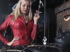 Smoking Mistress and suspended slave