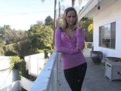 Aleska Diamond smokes on balcony