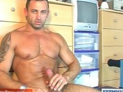 Sport guy serviced: Renato gets wanked his huge cock by our assistant!