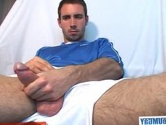 This soccer player gets wanked his huge hard cock by a gay guy ! woow!