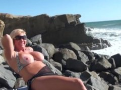 Big tits MILF flashes at beach