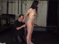 Rope bondage and sexy restrained kinky brunette struggling in hard tied