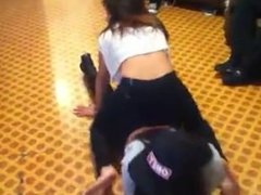 Two girls dance and grind on each other