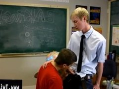 Gay porn Ace Sterling stands at the front of the classroom attempting to