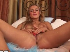 Passionate blondy Monica masturbates using a strap on
