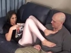 Step-Daughter puts her feet on the dad's face