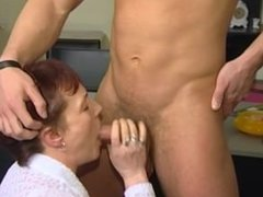 Mature red head fucks young guy in office
