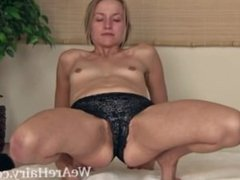 Hairy girl Rachel does her morning yoga and strips