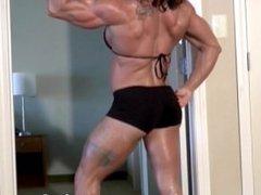 Anne Sheehan flexes her orgasmic rock hard body