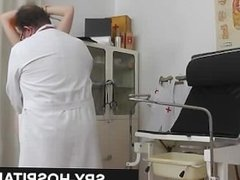 Doctor spying on seducing woman patient the babe is not aware of the hidden