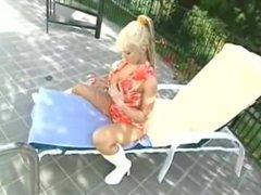 Blonde Nikki Sinn smoking