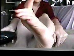 Woman Rubs Her Big Feet