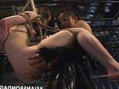 Japanese mistress fucks her slavegirl with strapon