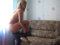 Russian girlfriend masturbates on her sofa