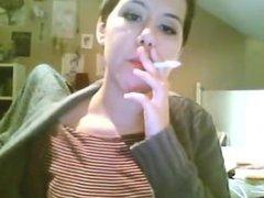 Short haired brunette smoking
