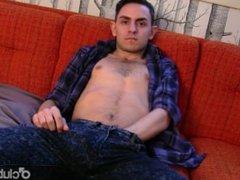 Sexual brunette straight guy Luke masturbating his large cock