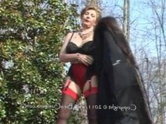 Lady in a fur coat masturbating outdoors.