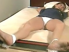 Feet tied ans slowly tickled tortured with brush