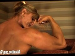 Big muscle goddess flexes her giant muscles