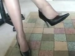 Sexy ebony dangling pumps in the office