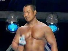 Offseason Asian Bodybuilder posing on TV