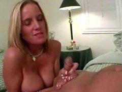 Big boobed girl gives great handjob and takes facial