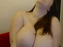 hot young latina shows off her massive tits on cam