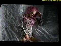 Pretty girl with pink hair masturbates
